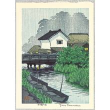 Kasamatsu Shiro: Riverside Village in Rain - Artelino
