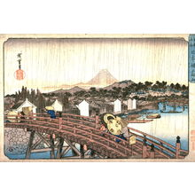 歌川広重: Light Rain on Nihon Bridge (Nihombashi no hakuu), from a series Famous Places in the Eastern Capital (Toto meisho) - Legion of Honor